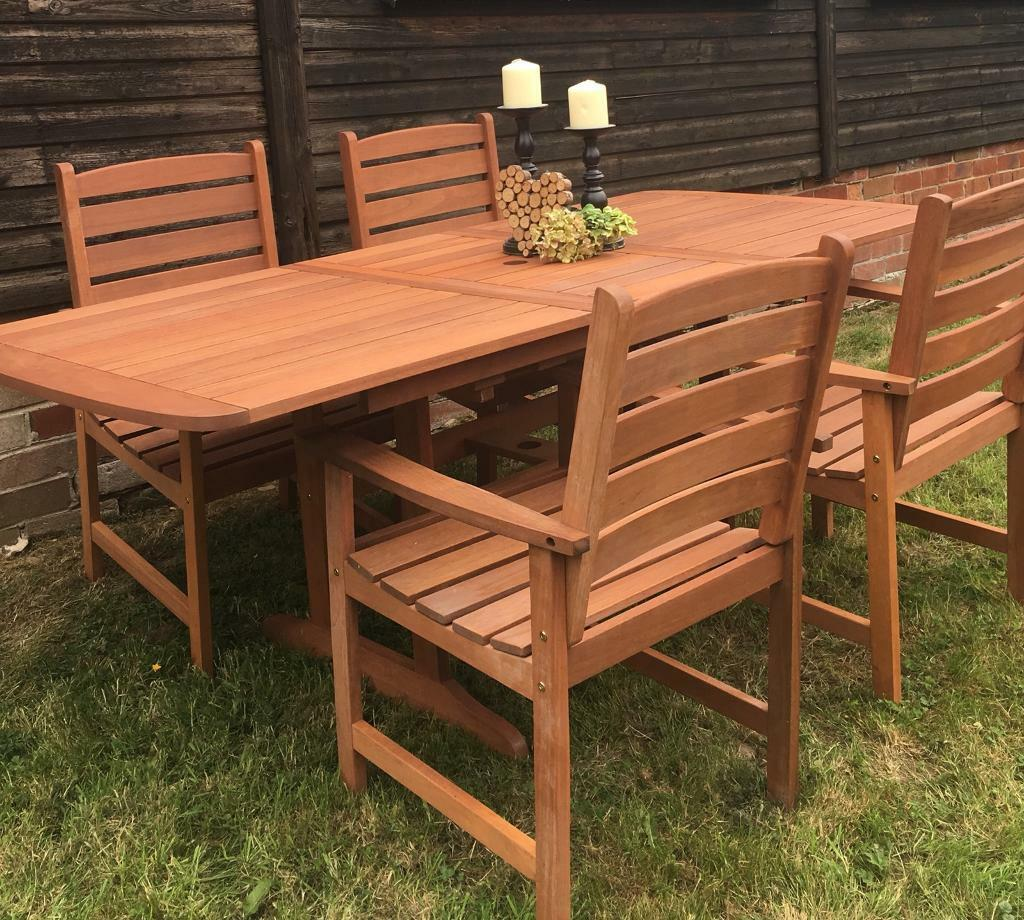 Stunning very solid brand new hardwood garden extending table and 4 chairs huddersfield