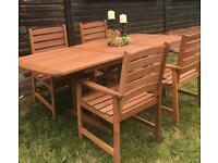 BRAND NEW HARDWOOD EXTENDING GARDEN TABLE AND 4 SOLID CARVER CHAIRS RRP £400