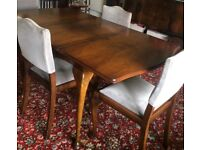 Walnut Queen Ann Style dining table and chairs. Excellent condition. Plus heatproof table cover