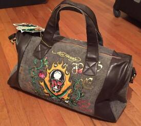Brand new with tag. Men's Ed Hardy duffle bag / weekend bag. Leather handles and edging