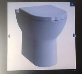Brand new Vitra S50 Comfort height back to wall WC with soft close seat
