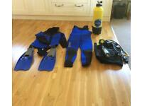 Mares Men's Wetsuit including flippers , oxygen tank, BCD and regulator package.