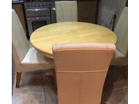 Country kitchen round table with 4 cushioned seats