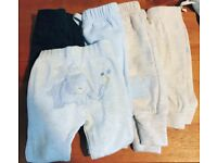 Boys 4 pairs of joggers and 1 pair soft cargo trousers 0-3 months