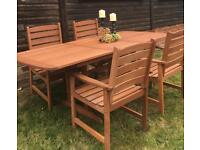 BRAND NEW IN BOX SOLID EXTENDING HARDWOOD GARDEN TABLE AND 4 CARVER CHAIRS CAN DELIVER