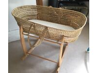 A Moses basket in an excellent condition with a rocking stand and mattress for £15 pick up only