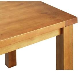 Solid dining table. Brand new/Sealed.