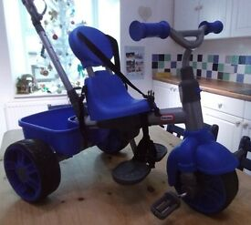 little tykes push or peddle trike in great condition 1year to 4 years