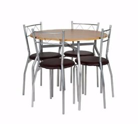 Dining Table and Chairs £40
