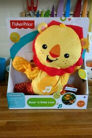 Fisher price roar n ride lion brand new and boxed