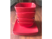 Set of red dinner plates and bowels
