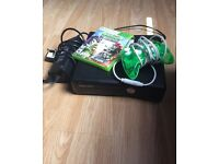 Xbox 360 with controller and game