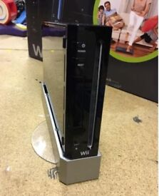 Black Nintendo Wii with original balance board, wii controller and numb chuck