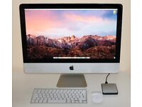 Apple iMac 21.5 inch, keyboard, mouse and external hard drive.