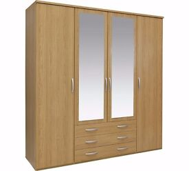 4 door, 3 drawer wardrobe in light oak with mirrors on 2 doors