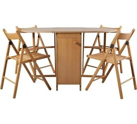 Wooden table and 4 chairs, space saving, great condition