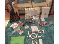 Wii console, Wii fit, guitar hero and games bundle