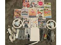 Wii bundle & 12 games including Mario kart & Wii party