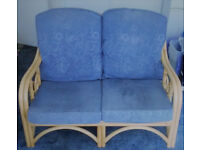 Bamboo two-seater sofa & matching footstool, with blue cushions - ideal for conservatory