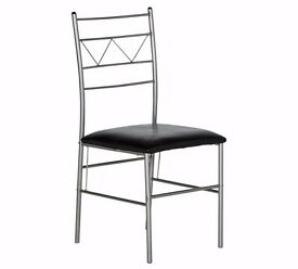 Silver dining chairs with black leather effect seats