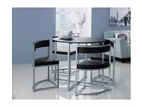 Black, round, hideaway Table and 4 x Chair set