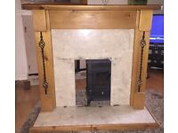 Antique solid pine fire surround with black wrought iron spindles and light marble hearth