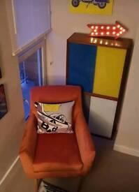 Brand new orange arm chair