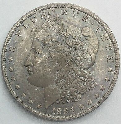 1884 O  MORGAN   LUSTROUS FULLY TONED BOTH  SIDES BU EXCELLENT EYE APPEAL