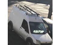 Ford Transit connect roof rack with rolling bar and ladder clamps.