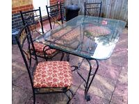 Outside table and 6 chairs very strong material