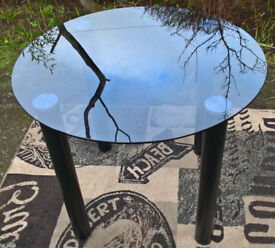 Ex-display Round Black Glass Dining Table.