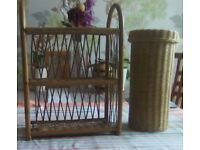 Two wicker items. One is a three shelf unit. One is a cylinder shape wicker toilet roll holder.