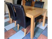 Table and 4 chairs in good condition!