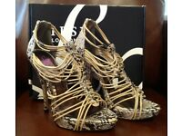 Brand New Lipsy strappy stunning cage style heels Size 5. Never worn