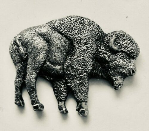 Copyrighted 1980 sculpture of a BUFFALO on the silver-like metal badge