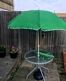 Outdoor table and parasol