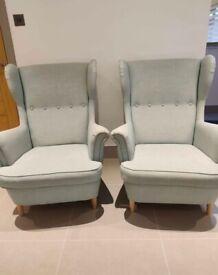 Two IKEA Strandmon Armchairs