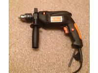 Electric hammer drill made by Challenge.