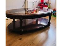 Vintage wooden table with large glass