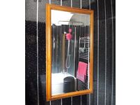 Large high quality bevelled carved-wood frame wall mirror (85 x 59cm)