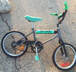 """Boy's 14"""" green bike"""