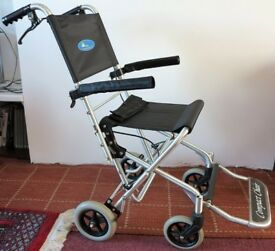 Wheelchair - small wheels and foldable with bag for easy storage