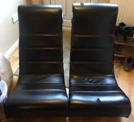 Two black gaming chairs. Leather effect. Will sell separately.