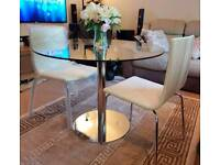John Lewis ENZO dining table with a pair of designer chairs