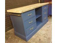 Freestanding kitchen island 6 deep drawers brass rails either side