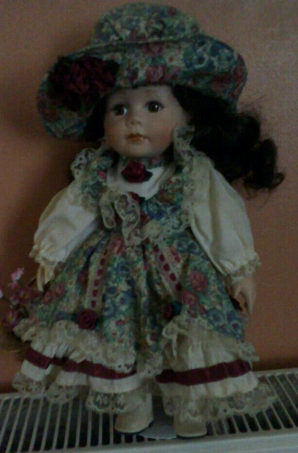 Lovely porcelain doll with stand