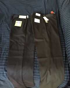 Two brand new dress pants with tags
