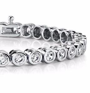 BEZEL SET DIAMOND TENNIS BRACELET - 6.40 CARATS, 14 KARAT WHITE GOLD