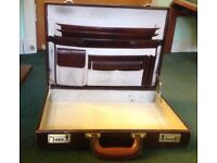 Briefcase, dark brown leather. Internally multiple pockets, pale leather, very clean. Locks.