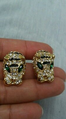 Beautiful vintage rhinestone  gold tone tiger clip on  earrings